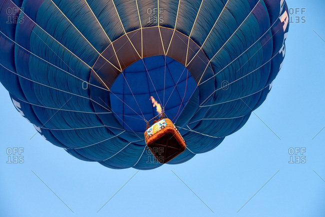 "Second day of hot air ballooning festival ""Sky fair"" in Kungur, Perm Krai, Russia. Blue balloon floating in clear sky"