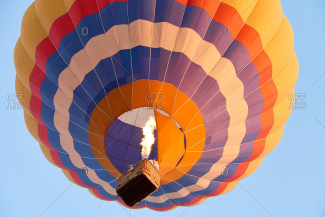 Low angle view of colorful hot air balloon floating in the air