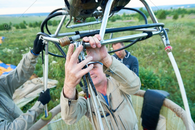 Hot air balloon crew fixing details of aircraft