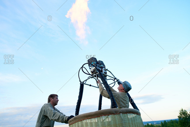 Hot air balloon crew checking gas burner before the flight