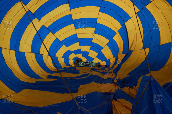 Blue and yellow hot air balloon being inflated