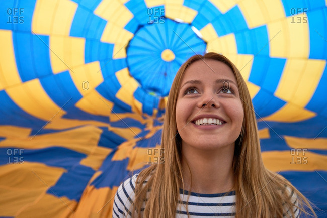Portrait of young girl against hot air balloon
