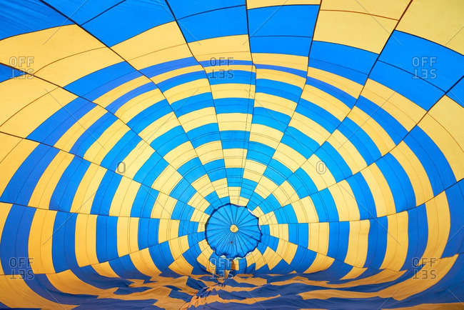 Bright blue and yellow hot air balloon