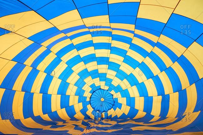 Bright blue and yellow hot air balloon