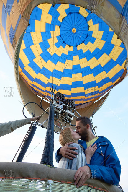Young couple kissing in hot air balloon