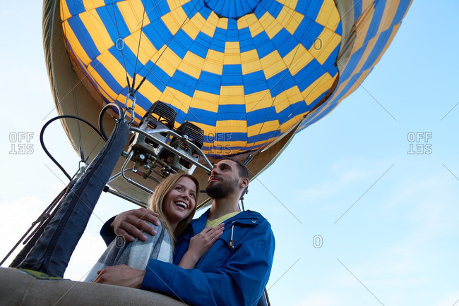 Happy couple having romantic date in hot air balloon