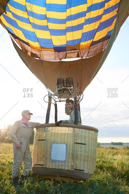 Hot air balloon crew a their aircraft