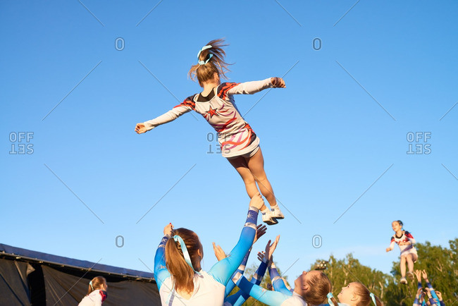 "Kungur, Perm Krai, Russia - June 25, 2016: Second day of hot air ballooning festival ""Sky fair"" in Kungur, Perm Krai, Russia. Cheerleaders performing routine before the show"