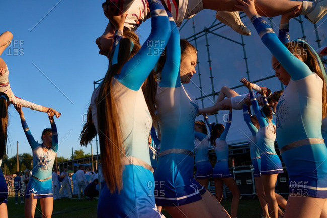 "Second day of hot air ballooning festival ""Sky fair"" in Kungur, Perm Krai, Russia. Cheerleaders performance before the show"