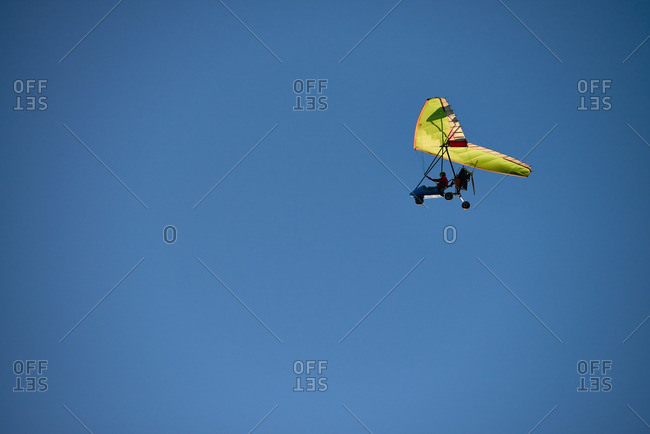 Man driving powered hang glider