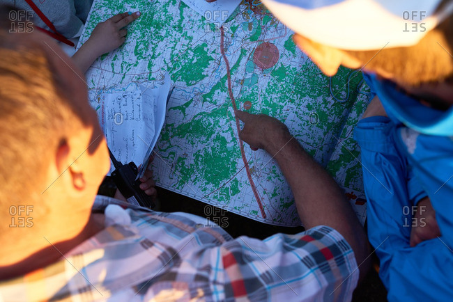 Men travellers checking the route on the map