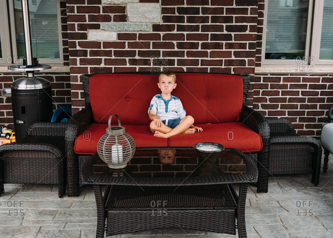 Boy making face on patio