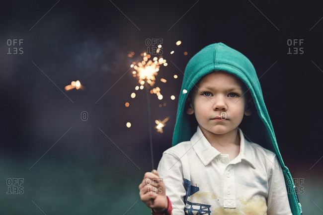 Boy holding up a sparkler