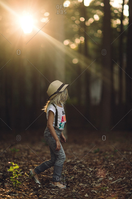 Girl in jeans walking in woods