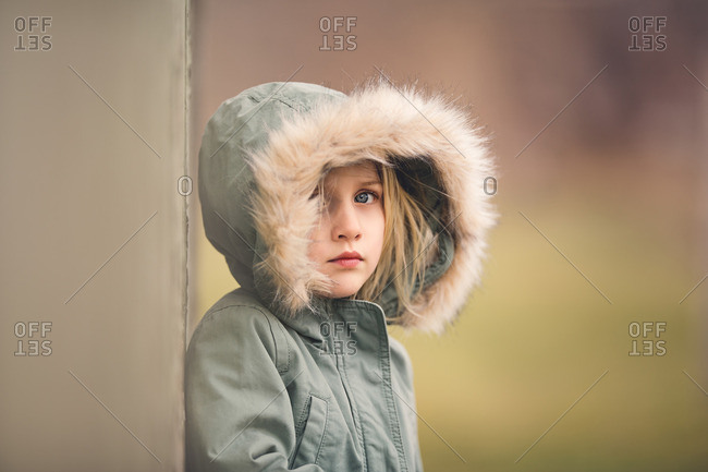 Girl in fur lined hooded jacket