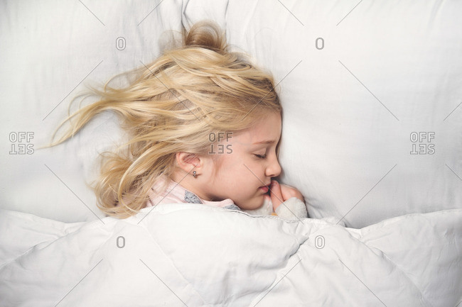 Girl sleeping in soft bed