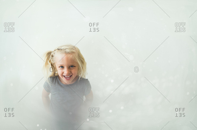 A girl seen through bubble wrap