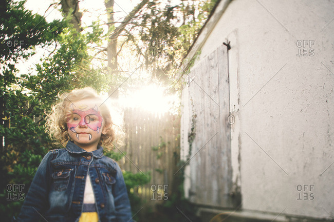 Kid with painted face in sunlight