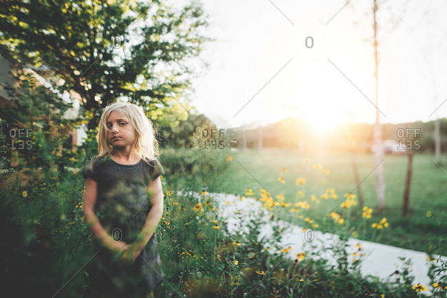 Blonde girl in summer flowers