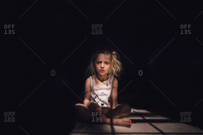 Girl with messy hair in light