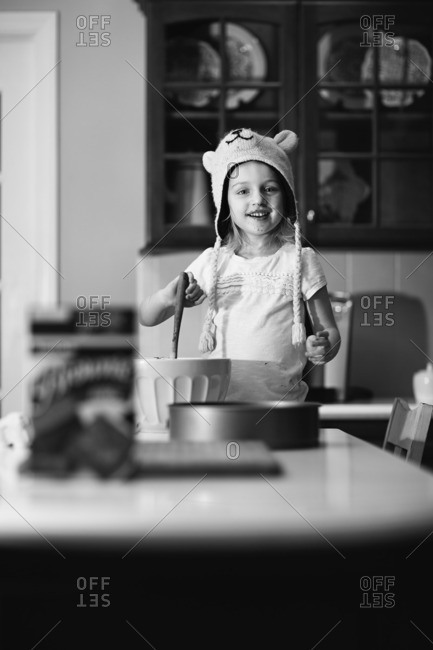Girl baking wearing animal hat