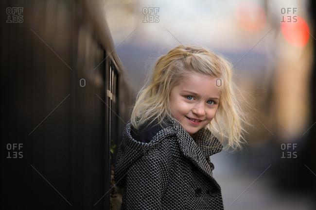 Girl in a hooded coat