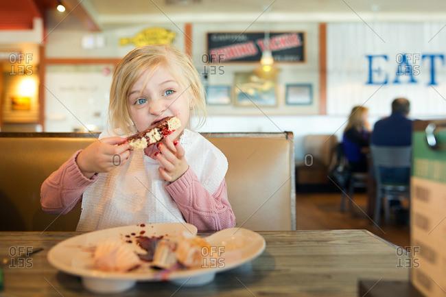 Girl eating messy dessert