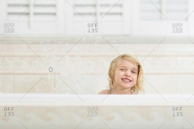 Grinning girl in bathtub