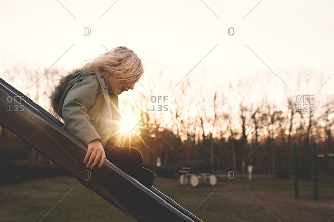 Excited girl on a slide