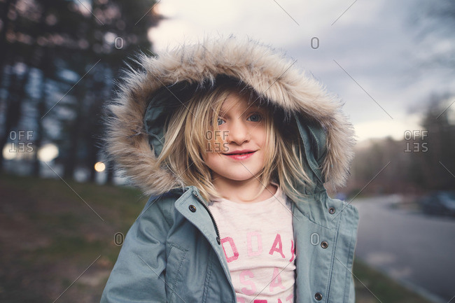Girl outside in fur lined coat