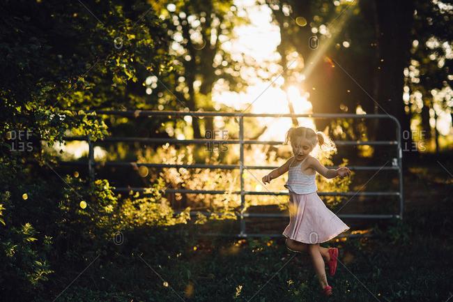 Girl dancing in rural setting