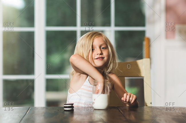 Girl dunking her cookie in milk