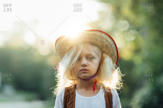 Serious girl in cowboy hat