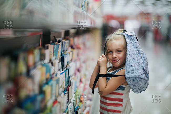 Girl by greeting cards with bag