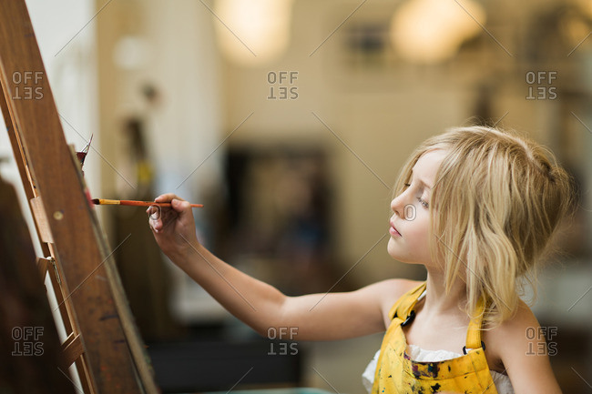 Girl painting with concentration