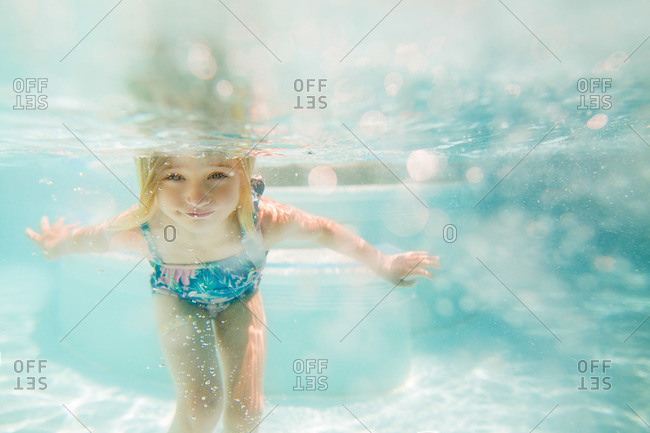Girl under water in a pool