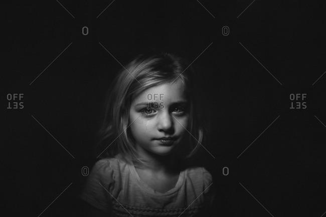 Girl in shadows crying
