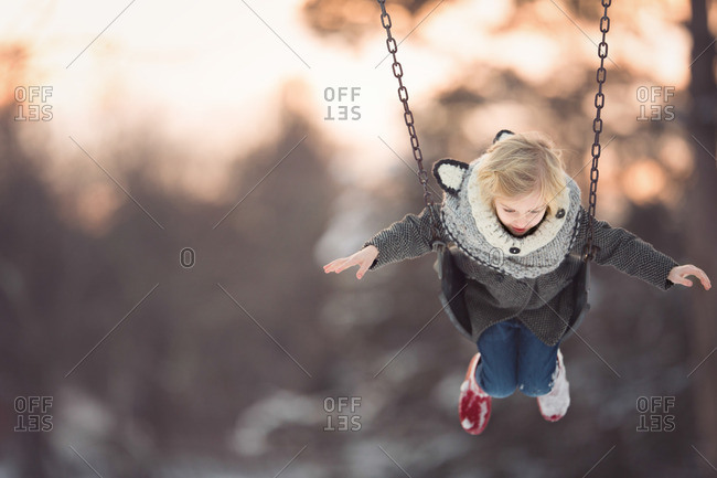 Girl on a swing in winter