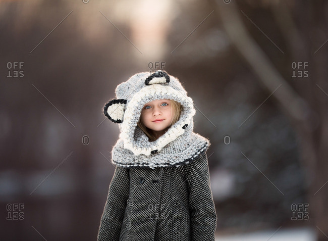 Girl in animal cowl in winter