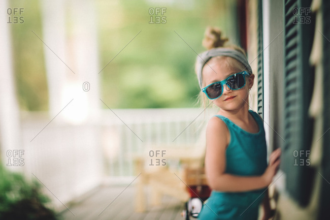 Girl in sunglasses on her porch