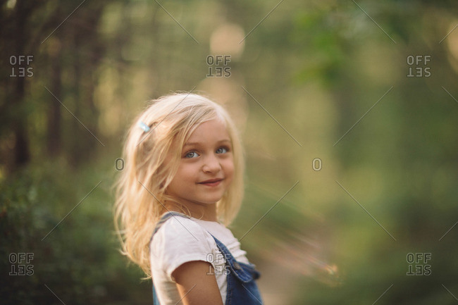 Girl in sunlight in the woods