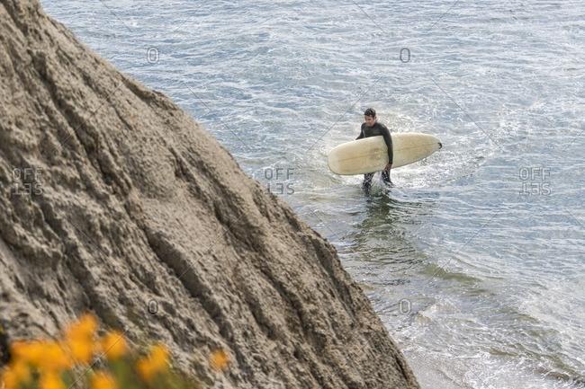 Surfer near Santa Cruz, California