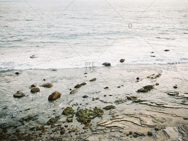 Waves breaking along a rocky shoreline