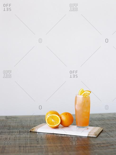 Orange juice drink on a cutting board
