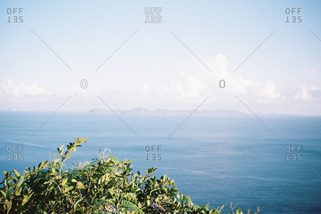Aerial view of open ocean and a distant mountain range