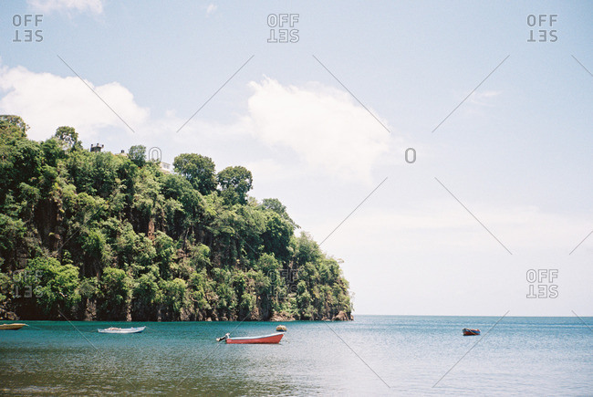 Boats anchored along a secluded island cove