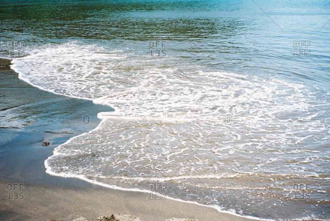 Waves along a sandy beach