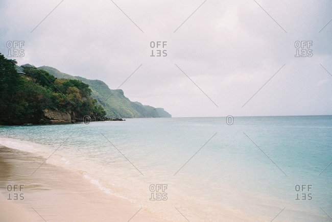 An empty beach along a mountainous coastline
