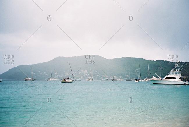 Boats anchored along a tropical island cove
