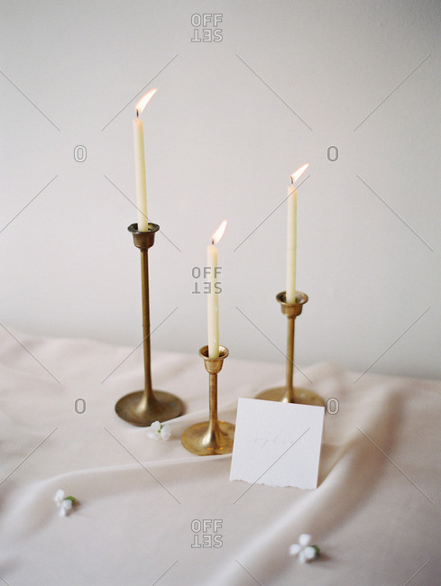 A table set with candles and a card